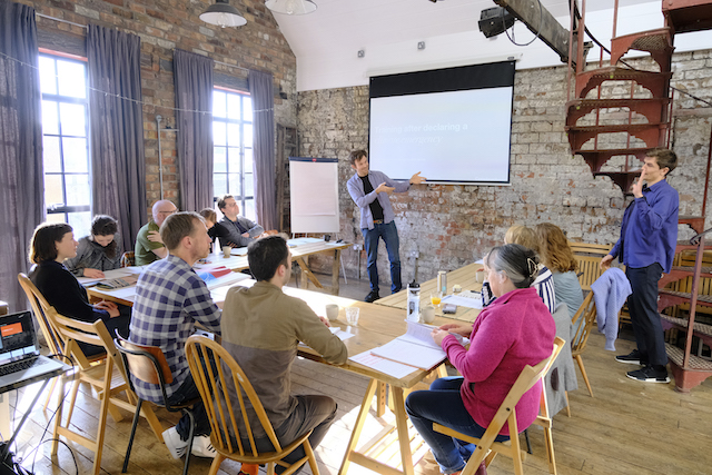 Image showing Oliver Broadbent and Bengt Cousins-Jenvey delivering a workshop to twelve people